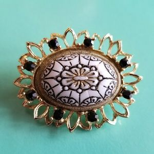 Vintage molded glass brooch gold tone black white